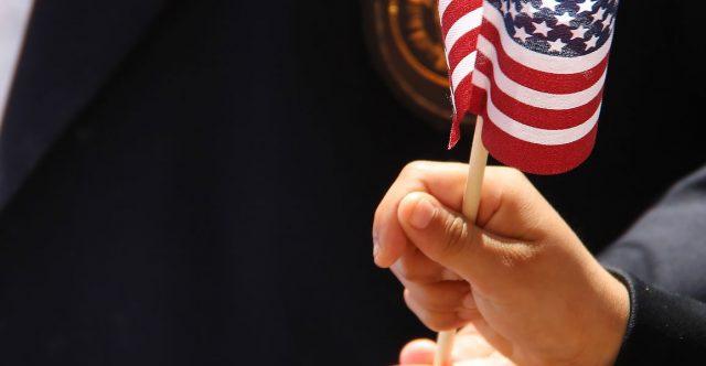 Child Hand Waving American Flag