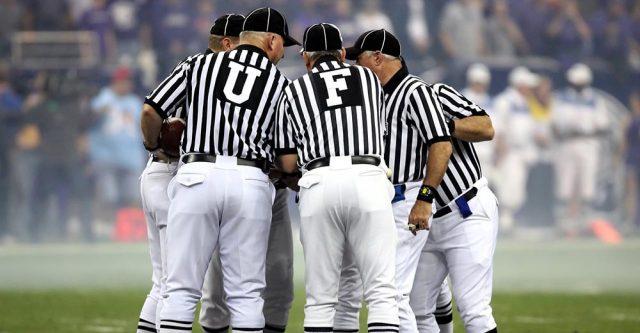 Football referee huddle.