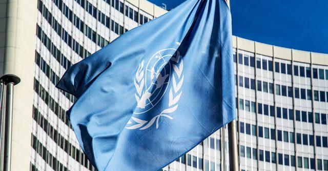 U.N. flag in front of building.