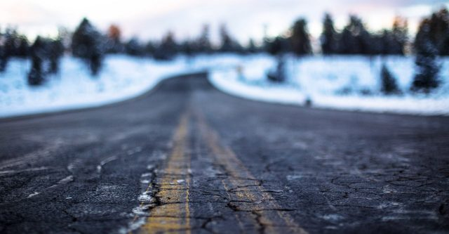 Cracked road with snow.