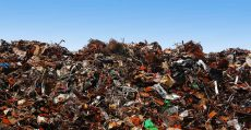 Landfill in front of blue sky.