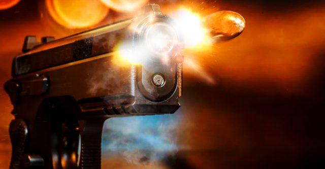 Pistol being fired.