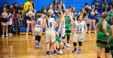 Lady's Comets playing basketball.