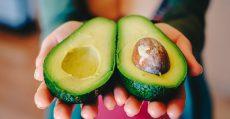 Ripe avocado cut in half.