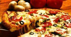 Slice of cheesy pizza.