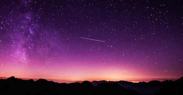 Stars in a purple sky.