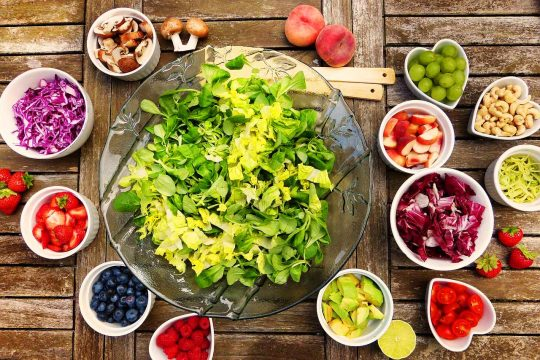 Bowl of salad and fresh vegetables.