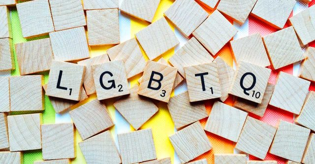 LGBTQ spelled out with scrabble pieces.