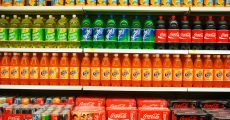 Aisle filled with soda.