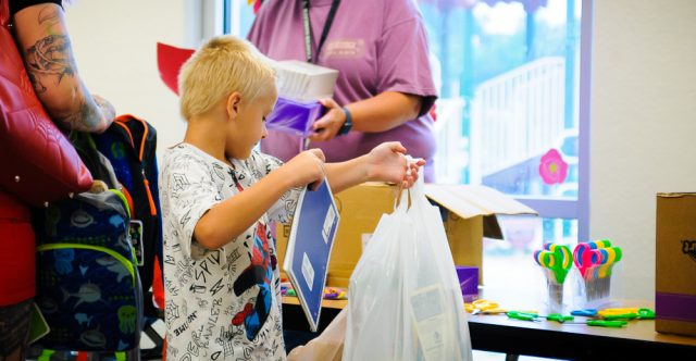 Kid gets school supplies.