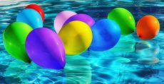 Colored balloons in pool.