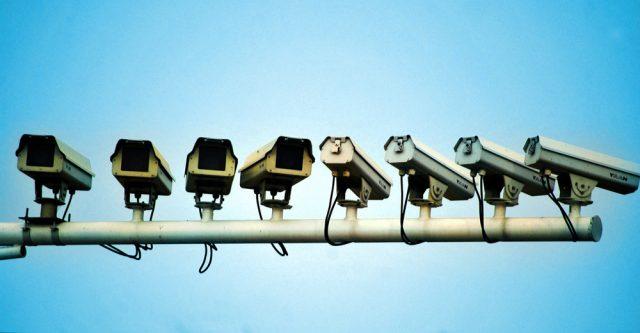Line of surveillance cameras.