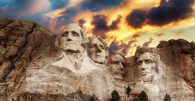 Mount Rushmore with clouds.