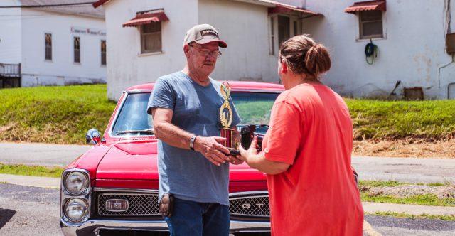 Larry Burnham, third place winner, pictured with Amanda Sisco, a Senior Center employee.