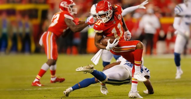 KANSAS CITY, MO - OCTOBER 06: Kansas City Chiefs Wide Receiver Demarcus Robinson (11) spins after the catch to avoid the tackle during the game between the Indianapolis Colts and the Kansas City Chiefs on October 6, 2019 at Arrowhead Stadium in Kansas City, MO. (Photo by Jeffrey Brown/Icon Sportswire)
