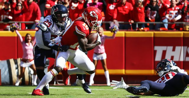 KANSAS CITY, MO - OCTOBER 13: Kansas City Chiefs wide receiver Tyreek Hill (10) comes down with a 46-yard reception in the first quarter of an NFL matchup between the Houston Texans and Kansas City Chiefs on October 13, 2019 at Arrowhead Stadium in Kansas City, MO. (Photo by Scott Winters/Icon Sportswire)