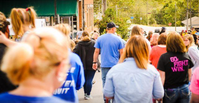 Man walking in crowd.