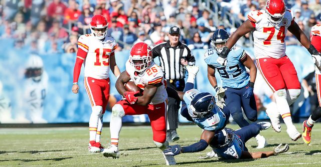 NASHVILLE, TN - NOVEMBER 10: Kansas City Chiefs running back Damien Williams (26) breaks free of Tennessee Titans free safety Kevin Byard (31) during a game between the Tennessee Titans and Kansas City Chiefs, November 10, 2019, at Nissan Stadium in Nashville, Tennessee. (Photo by Matthew Maxey/Icon Sportswire)