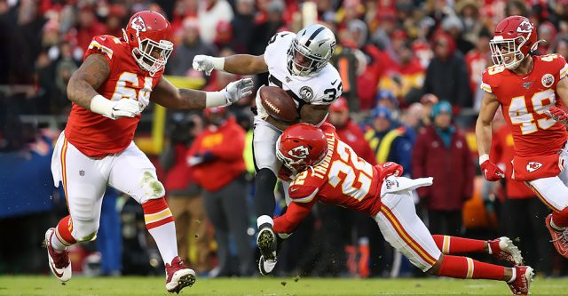 KANSAS CITY, MO - DECEMBER 01: Kansas City Chiefs free safety Juan Thornhill (22) tackles Oakland Raiders running back DeAndre Washington (33) during a kickoff return in the second quarter of an AFC West game between the Oakland Raiders and Kansas City Chiefs on December 1, 2019 at Arrowhead Stadium in Kansas City, MO. (Photo by Scott Winters/Icon Sportswire)