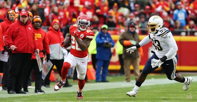 KANSAS CITY, MO - DECEMBER 29: Kansas City Chiefs running back Damien Williams (26) is pursued by Los Angeles Chargers defensive tackle Justin Jones (93) during a run in the second quarter of an AFC West game between the Los Angeles Chargers and Kansas City Chiefs on December 29, 2019 at Arrowhead Stadium in Kansas City, MO. (Photo by Scott Winters/Icon Sportswire)