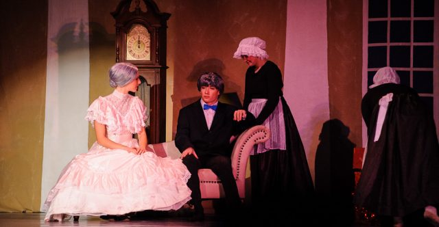 The Grandfather, James Dietsch, and the Grandmother, Tia Copling, talk with a lady in waiting at the start of the party.