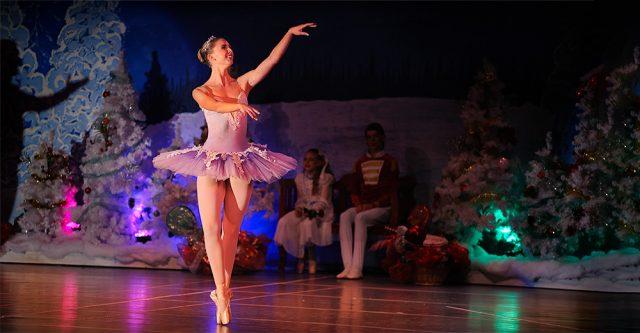 The Sugar Plum Fairy, Tia Copling, dances in the Nutcracker.