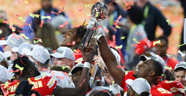 MIAMI GARDENS, FL - FEBRUARY 02: Kansas City Chiefs Defensive Tackle Chris Jones (95) holds up the Vince Lombardi Trophy on the podium after Super Bowl LIV on February 2, 2020 at Hard Rock Stadium in Miami Gardens, FL. (Photo by Rich Graessle/PPI/Icon Sportswire)