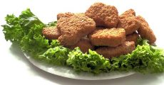 Chicken nuggets on lettuce.