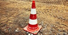 Construction cone in dirt.