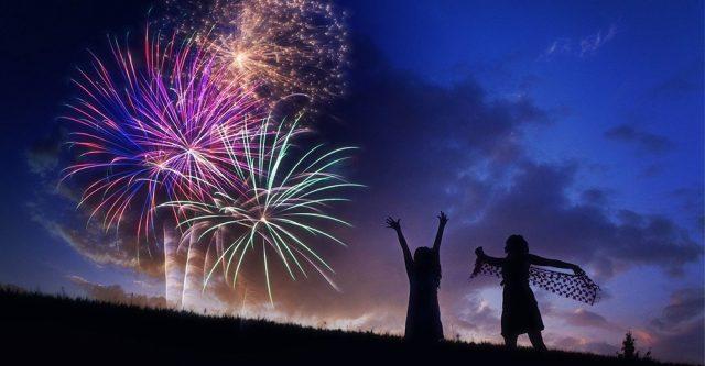 Children looking at fireworks.