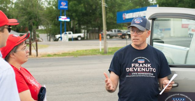 Frank Devenuto talking to citizens in alton.