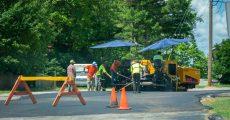 Road workers paving road, resurfacing
