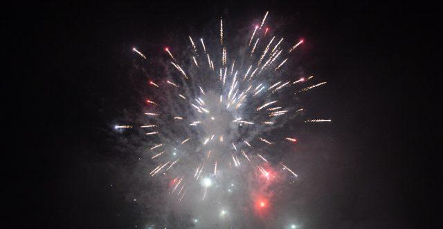 Fireworks over dark, smokey sky