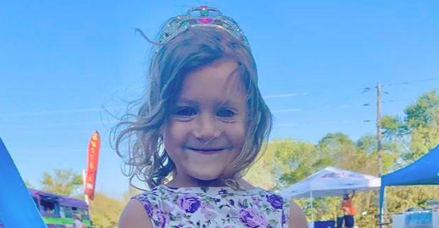 Little Anna Maxwell enjoys the festival with a balloon sword .