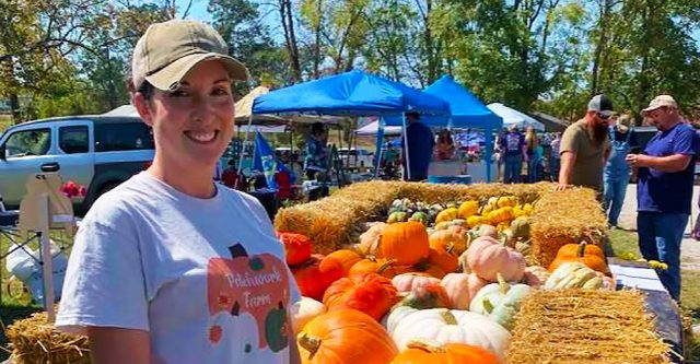 Stefanie Hobson of Patchwork Farms shows off her beautiful pumpkins, squash and mums.