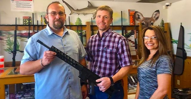 wo boys enjoy walking tacos and BBrent Campbell is the winner of the gun raffle. Joel Hinds and Rachel Wood presented the gun.