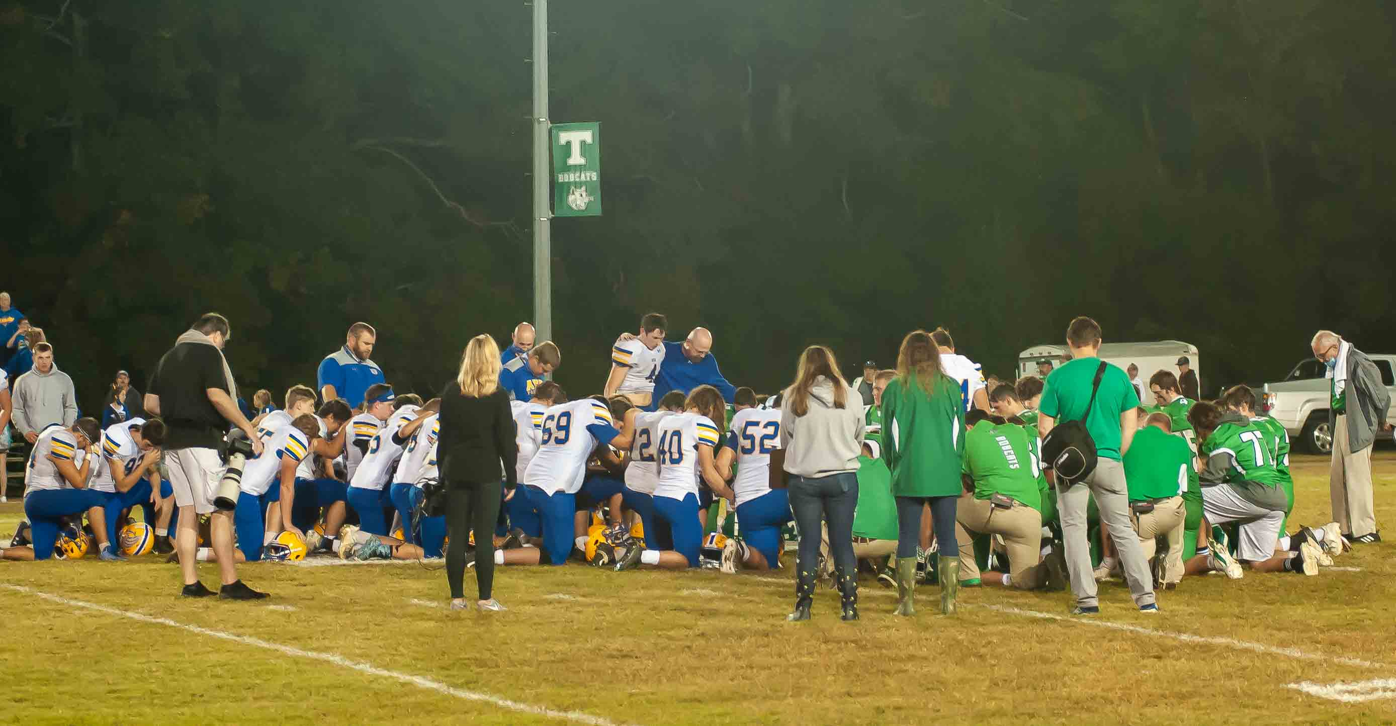THAYER, MO - OCTOBER 9: Thayer Bobcats and Ava Bears coaching staff and players pray together after the game during the high school football game between the Ava Bears and the Thayer Bobcats on October 9, 2020, at the Thayer High School football field in Thayer, MO. (Photo by Curtis Thomas/AltonMo.com)