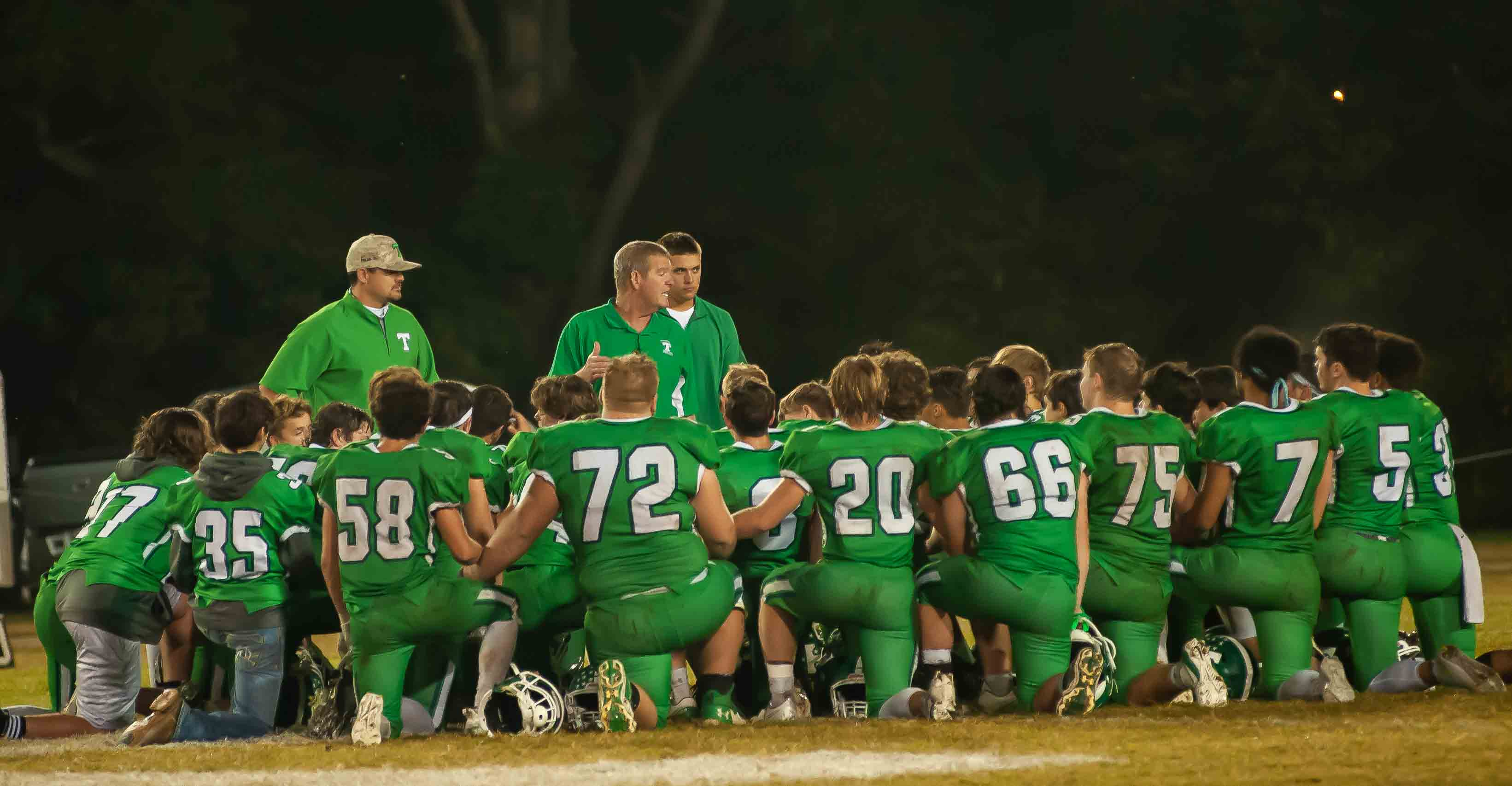 THAYER, MO - OCTOBER 9: Thayer Bobcats coaching staff and players kneel and pray after the game during the high school football game between the Ava Bears and the Thayer Bobcats on October 9, 2020, at the Thayer High School football field in Thayer, MO. (Photo by Curtis Thomas/AltonMo.com)