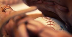 A baseball in side of a mitt