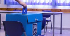 Person voting at a voting box