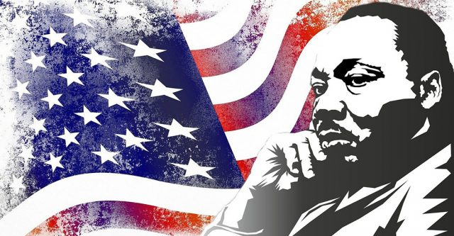 Martin Luther King Jr. in front of the American flag.