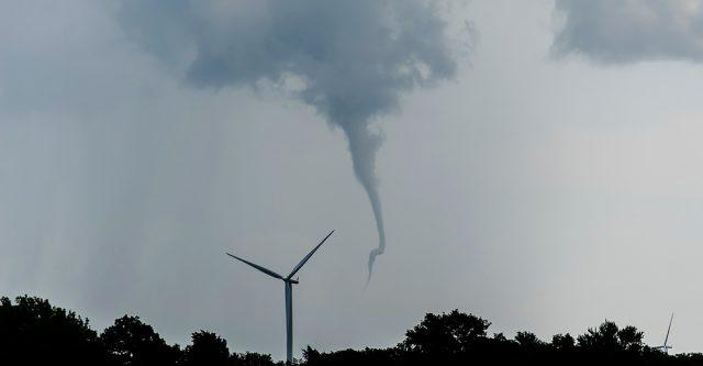 A tornado beginning as a funnel cloud