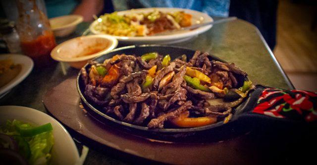 Jason's Mexican Restaurant Fajita meat in skillet.