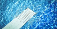 A diving board over pool