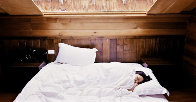 person sleeping in bed