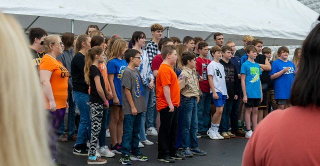 Alton Junior high and High school choirs performing at the walnut Festival