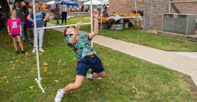 Gunner Kennedy doing limbo at the Alton Walnut Festival