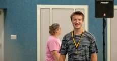 David Thomas receives Gold medal for first place in the Run the Town for the Gold 5k run in Alton, Mo.
